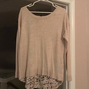 Women's sweater with underlay through open back
